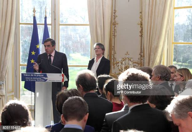 Chantal Didier President of the association of Ministries Press listens to France's Prime Minister Francois Fillon addressing press during the New...