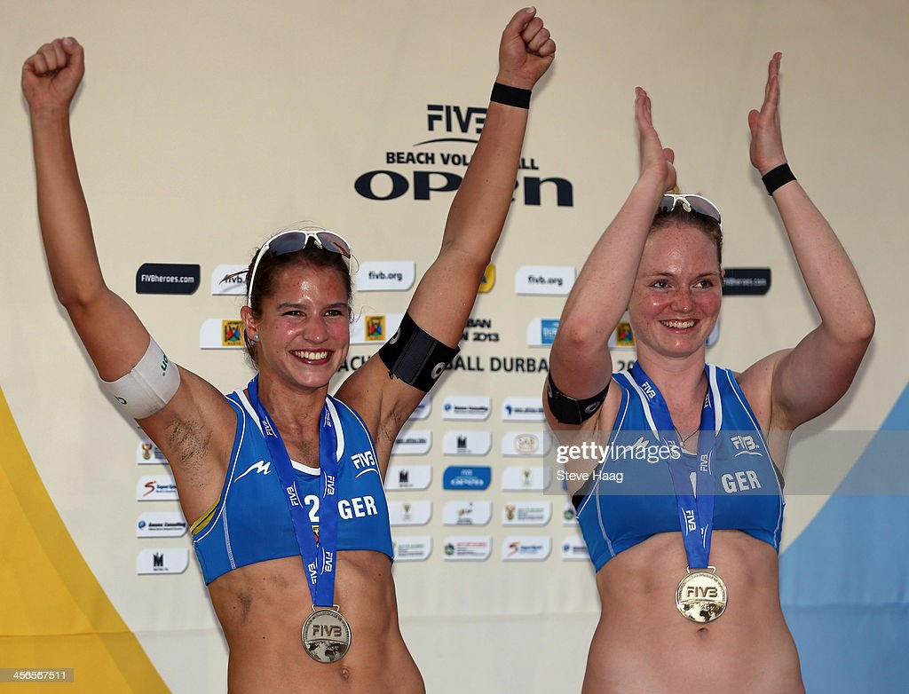 Chantal Laboureur (L) and Julia Sude of Germany celebrate during the medals ceremony at the FIVB Durban Open at New Beach on December 14, 2013 in Durban, South Africa.