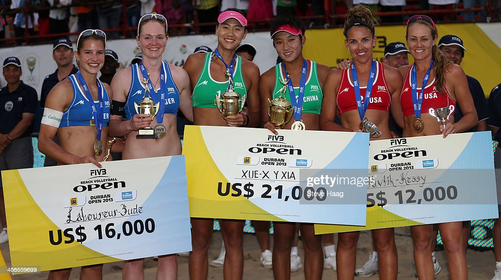 Chantal Laboureur and Julia Sude of Germany, Chen Xue and Xinyi Xia of China, and Whitney Pavlik and <a gi-track='captionPersonalityLinkClicked' href=/galleries/search?phrase=Jennifer+Kessy&family=editorial&specificpeople=2190049 ng-click='$event.stopPropagation()'>Jennifer Kessy</a> of the USA pose with their trophies and winnings during the medals ceremony at the FIVB Durban Open at New Beach on December 14, 2013 in Durban, South Africa.