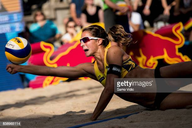 Chantal Laboureur of Germany receives the ball during the match against Larissa Franca Maestrini and Talita Da Rocha Antunes of Brazil during Day 3...