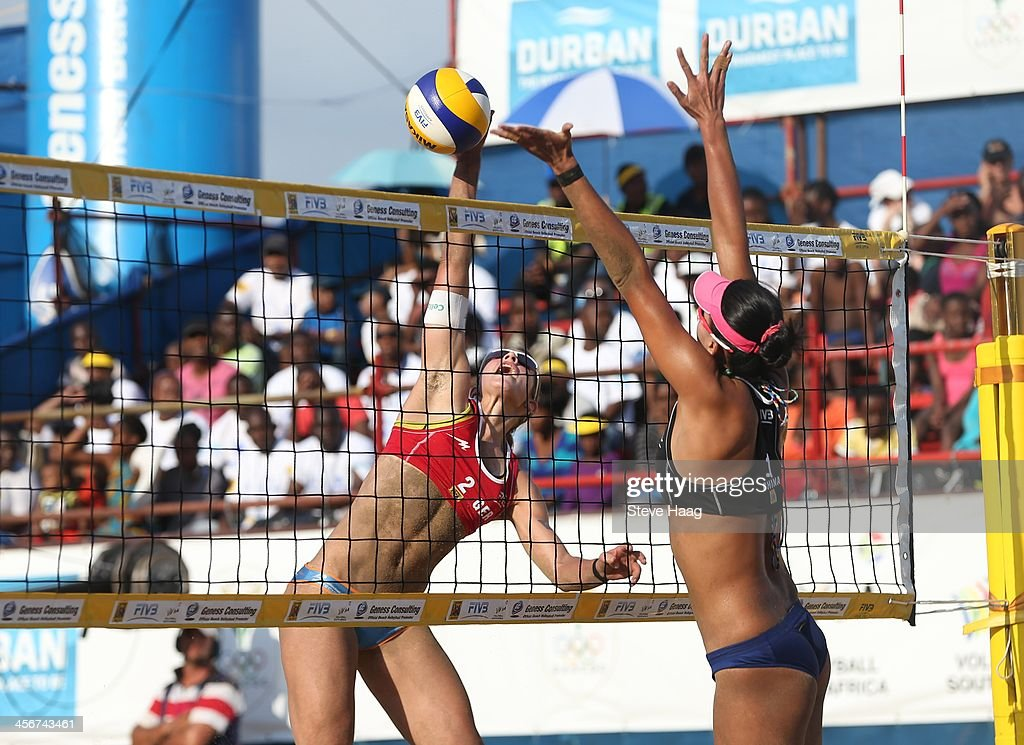 Chantal Laboureur of Germany spikes the ball past Chen Xue of China during the Women's final between Chen Xue and Xinyi Xia of China and Julia Sude and Chantal Laboureur of Germany at the FIVB Durban Open at New Beach on December 14, 2013 in Durban, South Africa.
