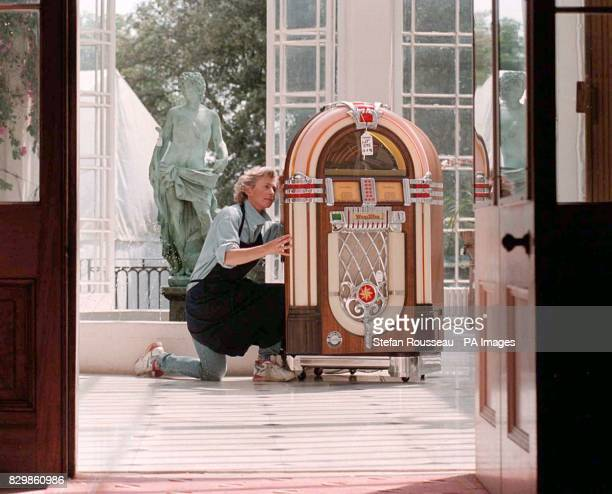 Chantal Langley of Sothebys looks at a Wurlitzer Compact Disc Juke Box owned by Lord Bristol at his home near Bury St Edmonds The juke box is one of...