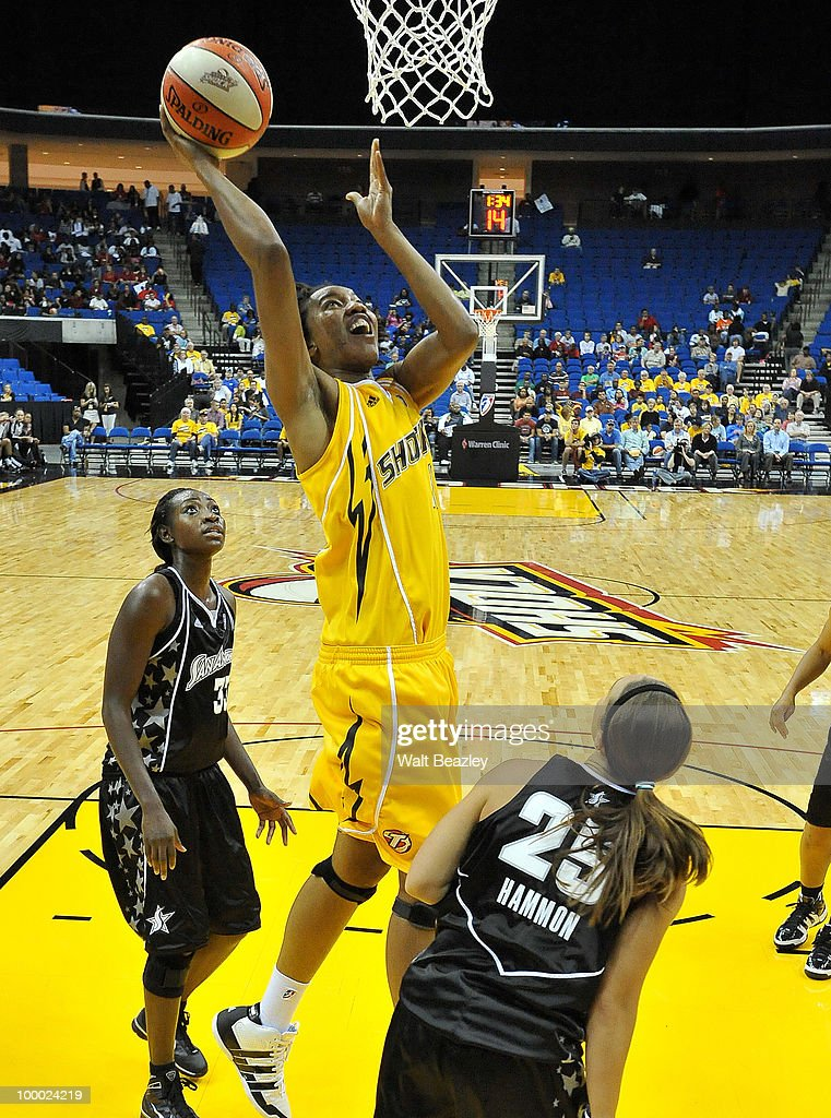 Chante Black #11 of the Tulsa Shock lays up a shot against Becky Hammon #25 of the San Antonio Silver Stars at the Bok Center May 20, 2010 in Tulsa, Oklahoma.
