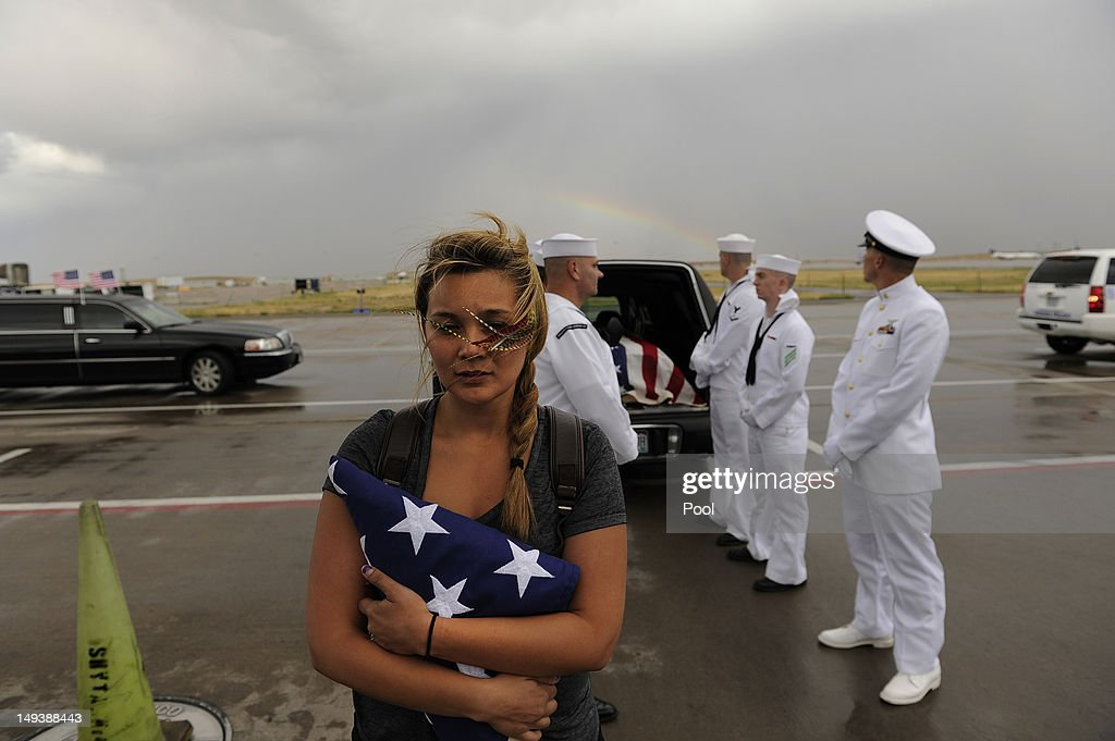 Chantel Blunk, wife of Jonathan Blunk, waits as the flag-draped casket bearing her husband's remains is loaded onto a plane bound for Reno for a full military funeral, at Denver International Airport July 27, 2012 in Denver, Colorado. Blunk, a five-year U.S. Navy veteran, was killed in the July 20 Century 16 shooting massacre in Aurora, Colorado.