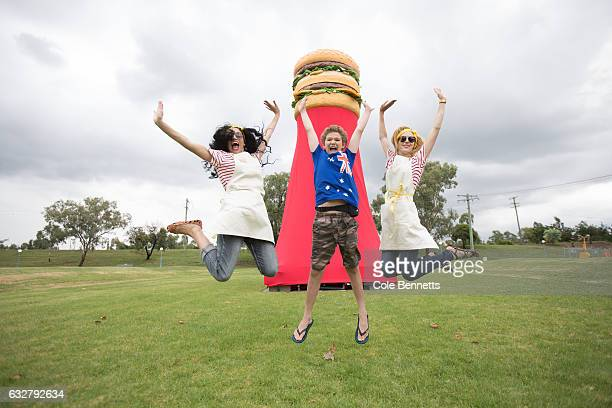 Chantelle Feasy Cody Small and Catherine Blitho jump high at the launch of the Down Under Big Big Mac on January 26 2017 in Tamworth Australia