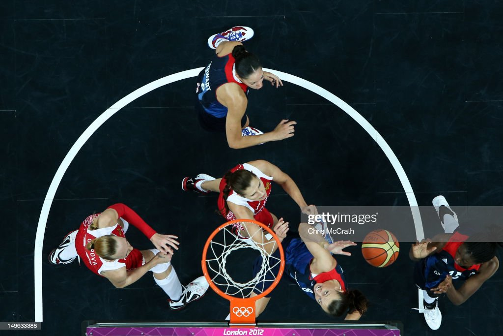 Chantelle Handy #8 of Great Britain shoots under pressure from Anna Petrakova #13 of Russia during the Women's Basketball Preliminary Round match on Day 5 of the London 2012 Olympic Games at Basketball Arena on August 1, 2012 in London, England.