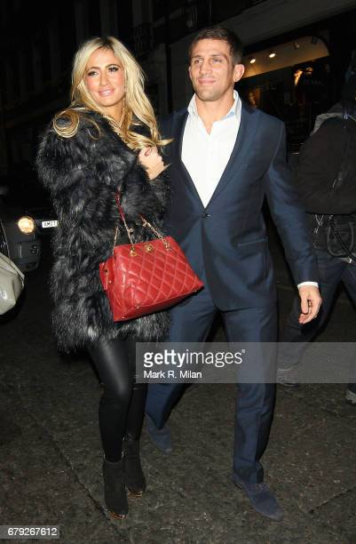 Chantelle Houghton and Alex Reid attend the launch of the Savile Row tailor Gary Anderson's new season collection on November 24 2011 in London...