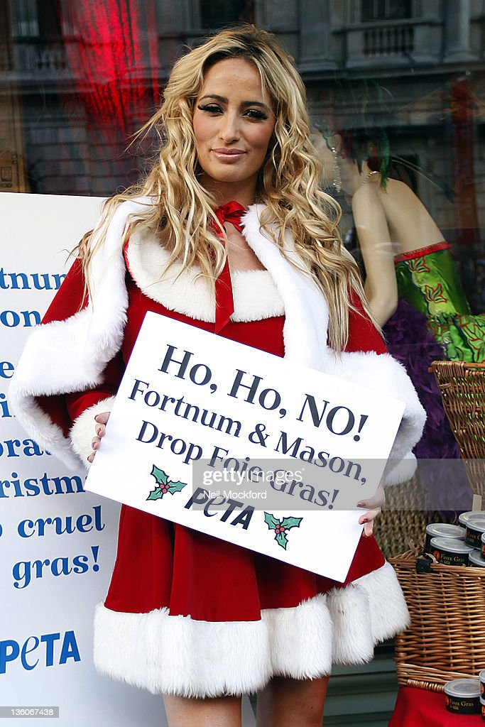 Chantelle Houghton hands out tins of faux Foie Gras in protest of Fortnum and Mason's continued sale of the product on December 22 2011 in London...
