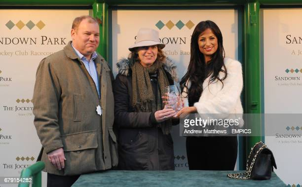 Chantelle Houghton presents the trophy to winning connections of Lord Protector after the S Creative PR And Talent Management Novices' Handicap Hurdle