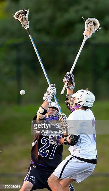 Chantilly's Ian Buck left and Battlefield's Scott Ratigan vie for a loose ball as Chantilly defeats Battlefield 9 8 in the boys Virginia AAA lacrosse...