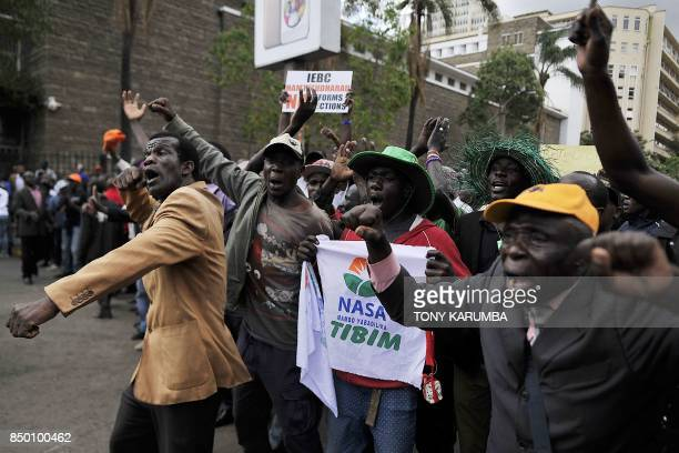 A chanting crowd of supporters of Kenya's main opposition National Super Alliance presidential flagbearer Raila Odinga gather September 20 outside...