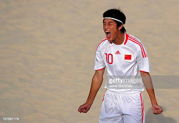 Chao Wan of China celebrates scoring a goal in the Men's Beach Soccer Quarterfinal between China and Syria at AlMusannah Sports City during day seven...