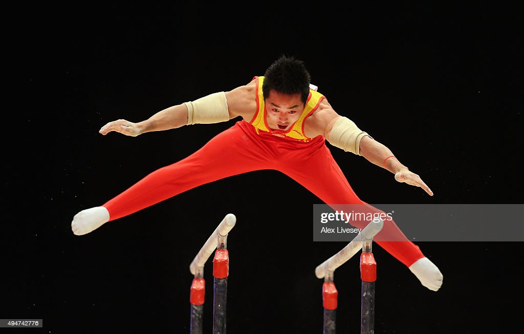 Chaopan Lin of China competes in the Parallel Bars during day six of the 2015 World Artistic Gymnastics Championships at The SSE Hydro on October 28, 2015 in Glasgow, Scotland.