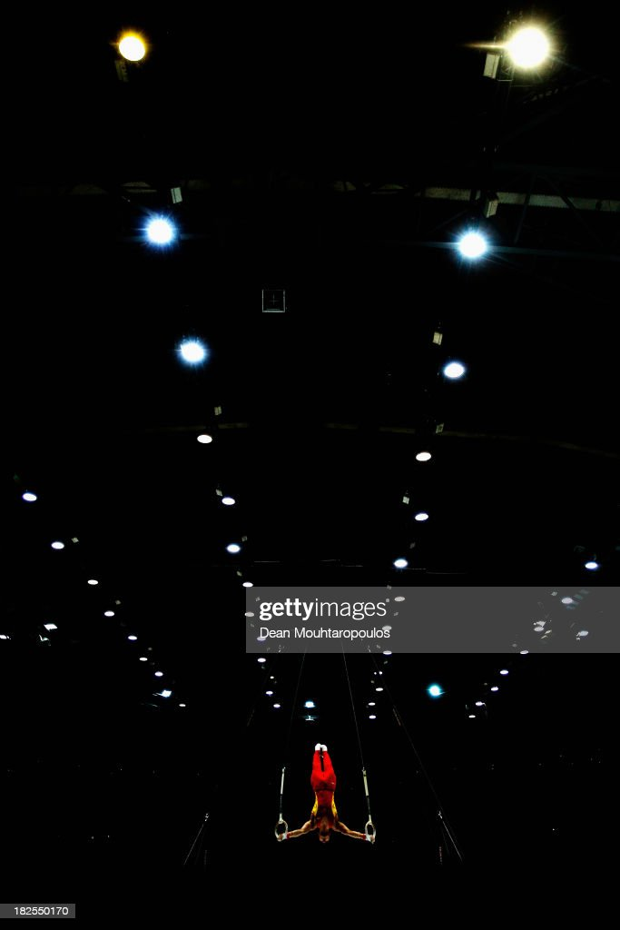Chaopan Lin of China competes in the Rings Qualification on Day One of the Artistic Gymnastics World Championships Belgium 2013 held at the Antwerp Sports Palace on September 30, 2013 in Antwerpen, Belgium.