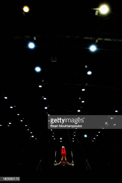 Chaopan Lin of China competes in the Rings Qualification on Day One of the Artistic Gymnastics World Championships Belgium 2013 held at the Antwerp...