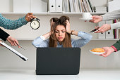 Frustrated young woman at work.