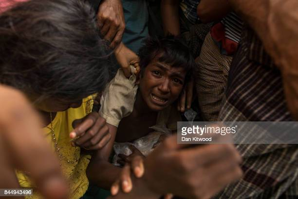 Chaotic scenes as rice is distributed to Rohingya refugees on September 09 2017 in Gundum Bangladesh Recent reports have suggested that around 290000...