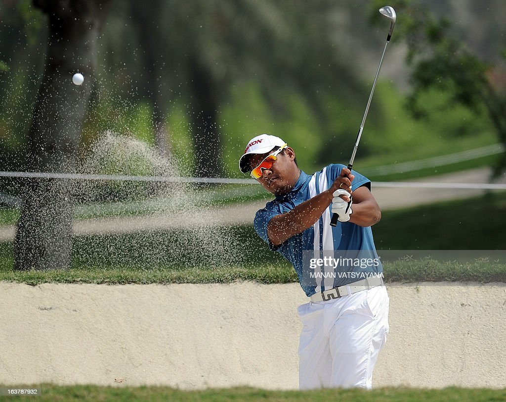 Chapchai Nirat of Thailand hits the ball out of a bunker on the second hole during the Avantha Masters golf tournament in Greater Noida, on the outskirts of New Delhi, on March 16, 2013.