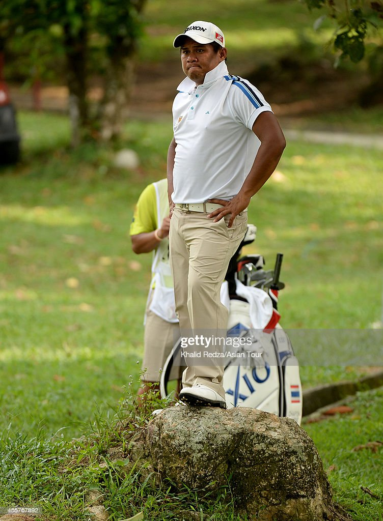 <a gi-track='captionPersonalityLinkClicked' href=/galleries/search?phrase=Chapchai+Nirat&family=editorial&specificpeople=812742 ng-click='$event.stopPropagation()'>Chapchai Nirat</a> of Thailand plays a shot during round three of the Worldwide Holdings Selangor Masters at Seri Selangor Golf Club on September 20, 2014 in Petaling Jaya, Malaysia.