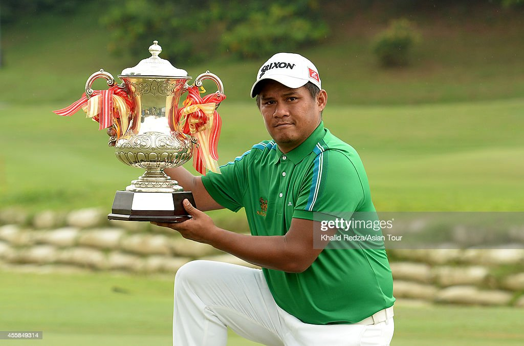 <a gi-track='captionPersonalityLinkClicked' href=/galleries/search?phrase=Chapchai+Nirat&family=editorial&specificpeople=812742 ng-click='$event.stopPropagation()'>Chapchai Nirat</a> of Thailand posing with the trophy after winning of the Worldwide Holdings Selangor Masters at Seri Selangor Golf Club on September 21, 2014 in Petaling Jaya, Malaysia.