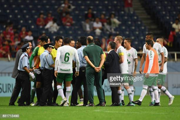 Chapecoense players and staffs protest to the match officials while security staffs intervene after their 01 defeat in the Suruga Bank Championship...