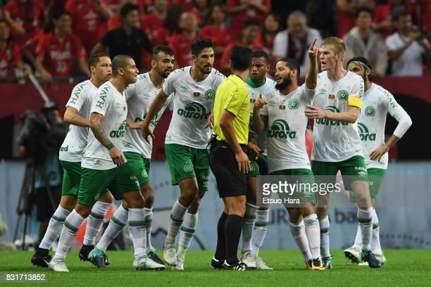 Chapecoense players protest to referee Kim Jonghyeok against the penalty decision during the Suruga Bank Championship match between Urawa Red...