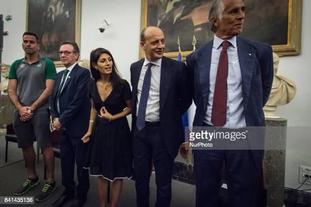 Chapecoense soccer team president Plinio Davide De Nes Filho with Rome's Mayor Virginia Raggiand the Director General of As Roma Mauro Baldissoni...