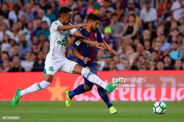Chapecoense's midfielder Lucas Mineiro vies with Barcelona's Uruguayan forward Luis Suarez during the 52nd Joan Gamper Trophy friendly football match...