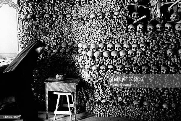 A chapel constructed of bones from humans who perished from the plague in the Middle Ages A priest from that era collected all the bones of the...