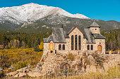 Chapel on the Rock, Church of Saint Malo near Estes Park. Season changing from autumn to winter. Rocky Mountains, Colorado, USA.