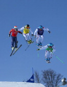 JF Chapuis Arnaud Bovolenta Jonathan Midol of France and Brady Leman of Canada make a jump in the final during the Mens Ski Cross Freestyle Skiing at...