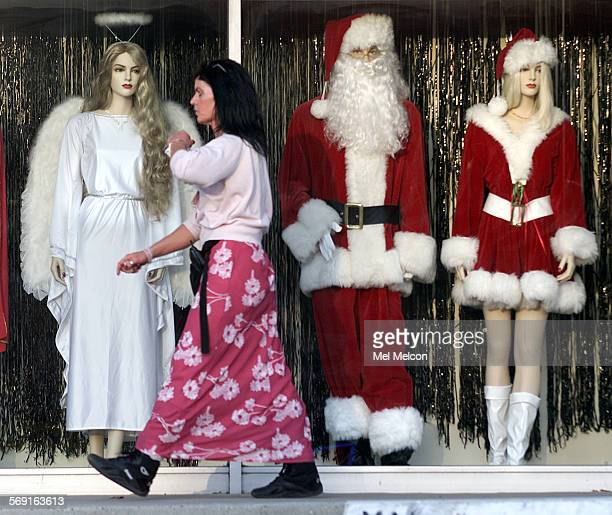 Char Brown walks past manniquins on display in window of costume shop in strip mall located on Thousand Oaks Blvd in Thousand Oaks She was making her...