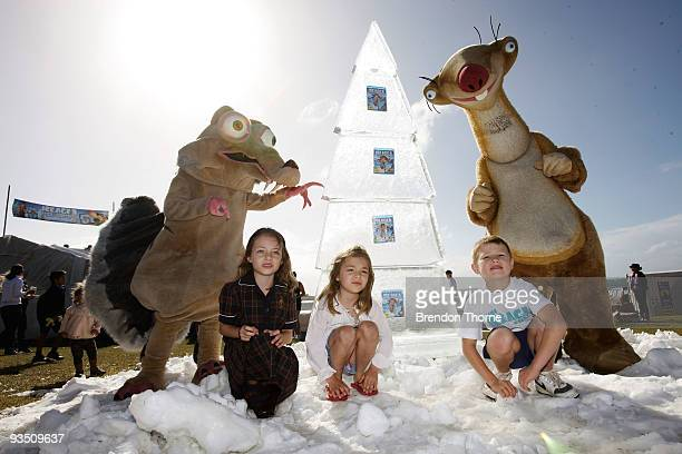 Characters from Ice Age pose with children as Bondi Beach is tranformed into a winter wonderland on the first official day of summer in Sydney at...