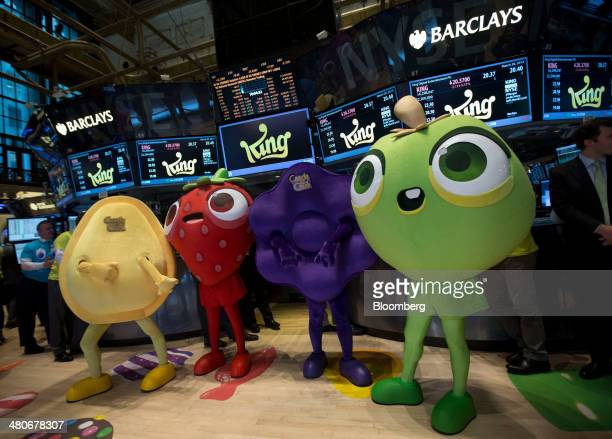 Characters from King Digital Entertainment Plc's 'Candy Crush' game stand for a photograph in front of a trading post on the floor of the New York...