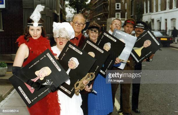 Characters from the board game Cluedo poses for the media during a photocall outside the Sherlock Holmes Hotel in London's Baker Street this morning...