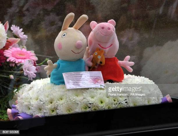 Characters from the children's television show Peppa Pig are placed in a hearse carrying a child's coffin as it arrives at St Mary's Church in...