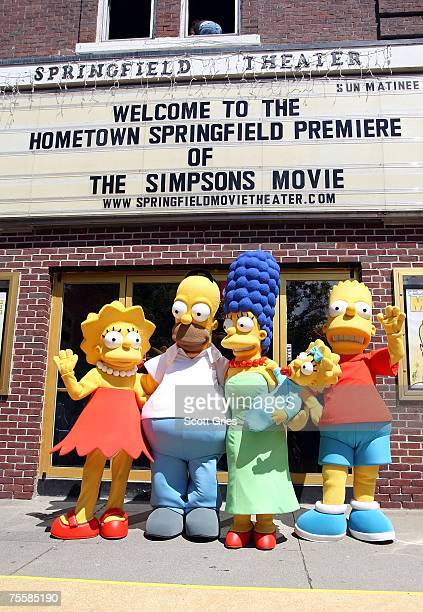 Characters from the film pose for photos during the hometown premiere of 'The Simpsons Movie' on July 21 2007 in Springfield Vermont
