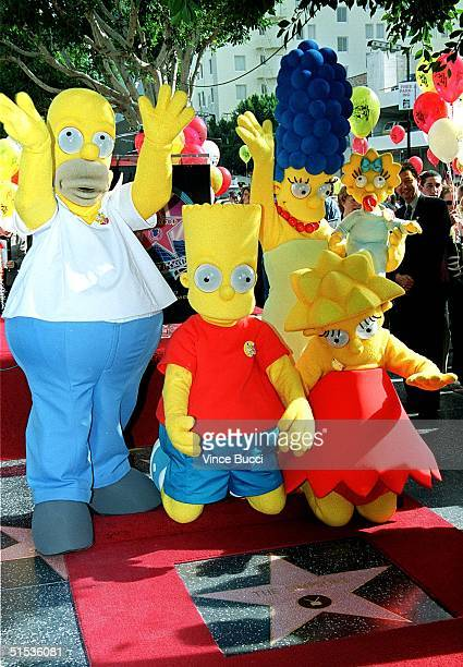 Characters from 'The Simpsons' Homer Bart Lisa Marge and baby Maggie stand next to the star they received 14 January 2000 on the famous Hollywood...