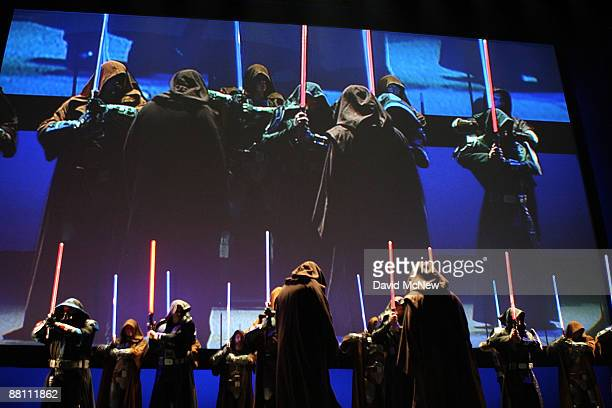 Characters wearing robes and wielding lightsabers take to the stage to promote Star Wars The Old Republic at the Entertainment Software Association...