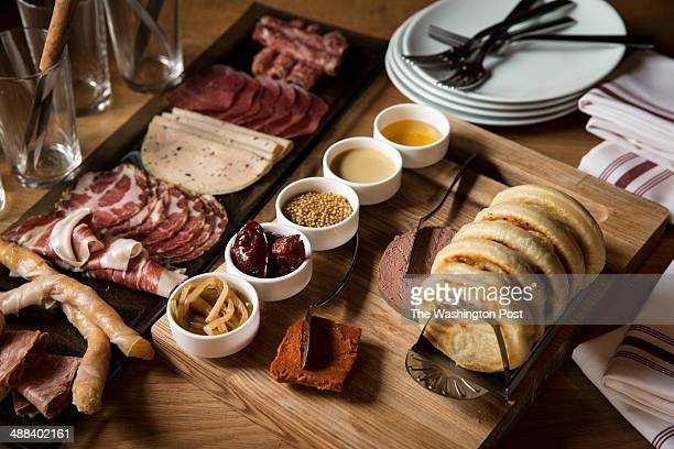 Charcuterie at The Partisan restaurant in Washington DC 2014 The Charcuterie selction is comprised of Campari Rosemary Orange Salami Thai Basil...