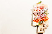 Charcuterie assortment and cheese on wooden board