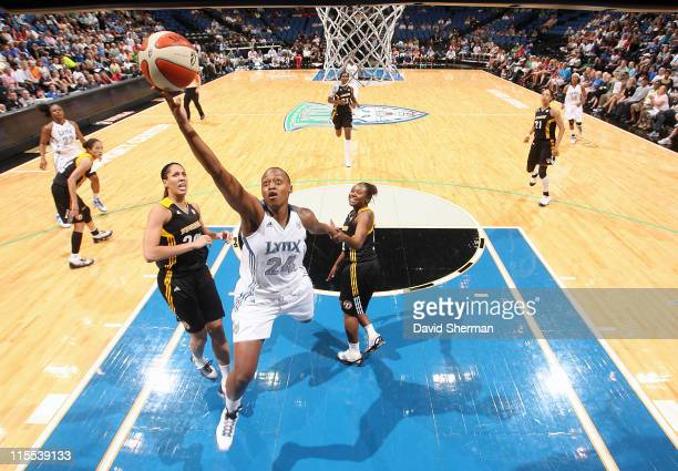 Charde Houston of the Minnesota Lynx goes for the layup against Miranda Ayim and Andrea Riley of the Tulsa Shock during the game on June 7 2011 at...