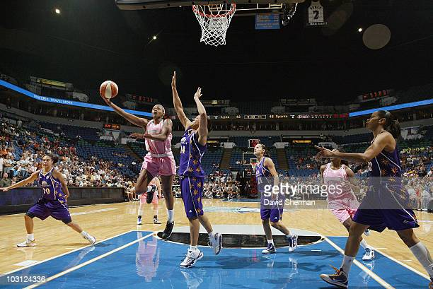 Charde Houston of the Minnesota Lynx goes to the basket against Lindsay WisdomHylton of the Los Angeles Sparks during the game on July 27 2010 at the...