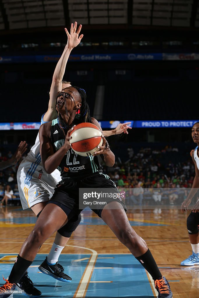 <a gi-track='captionPersonalityLinkClicked' href=/galleries/search?phrase=Charde+Houston&family=editorial&specificpeople=7028631 ng-click='$event.stopPropagation()'>Charde Houston</a> #22 of the New York Liberty drives on Allie Quigley #14 of the Chicago Sky during the game on July 31, 2014 at Allstate Arena in Rosemont, Illinois.
