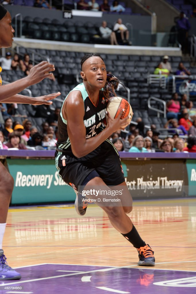 <a gi-track='captionPersonalityLinkClicked' href=/galleries/search?phrase=Charde+Houston&family=editorial&specificpeople=7028631 ng-click='$event.stopPropagation()'>Charde Houston</a> #22 of the New York Liberty drives to the basket against the Los Angeles Sparks at STAPLES Center on July 23, 2014 in Los Angeles, California.