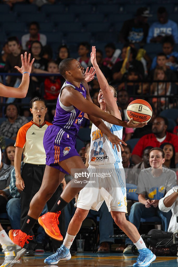 Charde Houston #22 of the Phoenix Mercury shoots against Courtney Vandersloot #22 of the Chicago Sky during the game on September 11, 2013 at the Allstate Arena in Rosemont, Illinois.