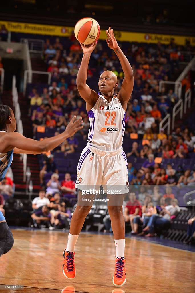 <a gi-track='captionPersonalityLinkClicked' href=/galleries/search?phrase=Charde+Houston&family=editorial&specificpeople=7028631 ng-click='$event.stopPropagation()'>Charde Houston</a> #22 of the Phoenix Mercury shoots against the Minnesota Lynx on July 21, 2013 at U.S. Airways Center in Phoenix, Arizona.