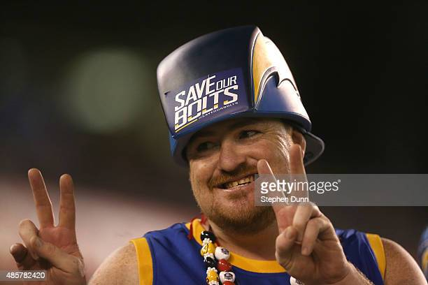Charger fan wears a helmet with 'Save Our Bolts' pritned on it during the game between the Seattle Seahawks and the San Diego Chargers during...