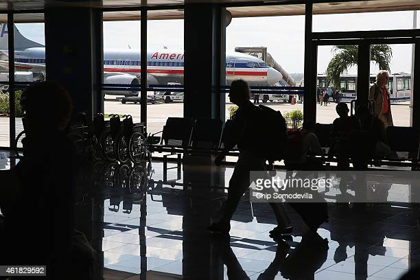 A charger jet operated by American Airlines is parked on the tarmac at Jose Marti International Airport after flying directly from Miami January 19...