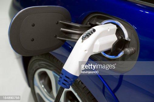 Charging an electric car close up